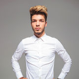 Attractive young man in casual shirt with hands on waist Royalty Free Stock Photos