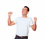 Attractive young man celebrating his victory Stock Photos