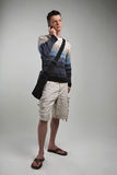 Attractive young man on cellphone. With bag Royalty Free Stock Image