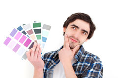 Attractive young man choosing color of his flat Stock Photography