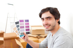 Attractive young man choosing color of his flat Stock Image