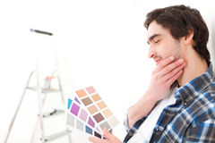 Attractive young man choosing the color of his flat Stock Image