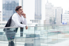 Attractive young man is communicating on the Royalty Free Stock Images
