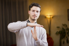 Attractive young man doing time-out sign Royalty Free Stock Images