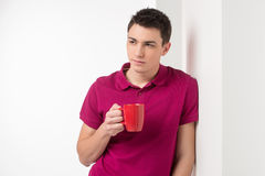 Attractive young man drinking coffee. Stock Photos