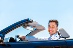 Attractive young man driving convertible. Stock Photography