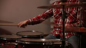Attractive young man drummer playing on his kit stock footage