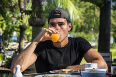 Attractive Young Man Eating Breakfast stock photography