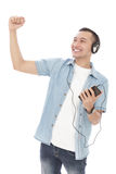Attractive young man enjoy listening music on mobilephone with h Royalty Free Stock Photos