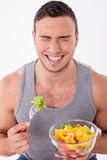 Attractive young man is enjoying healthy food Stock Image