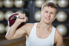 Attractive Young Man Exercising With Kettlebell In Gymnasium Royalty Free Stock Photo