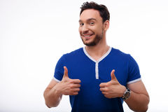 Attractive young man is expressing positive Stock Photos
