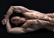Attractive young man on the floor with muscular ripped body stock photos
