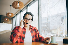 Attractive young man or freelancer is sitting in cafe stock photo