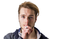 Attractive young man gesturing Hush or Silence Royalty Free Stock Photos