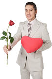 Attractive young man giving a love gift Stock Photography