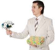 Attractive young man giving a love gift Royalty Free Stock Images