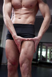 Attractive young man in gym. Royalty Free Stock Photography