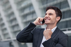 Attractive young man has succeeded in his business Royalty Free Stock Photography