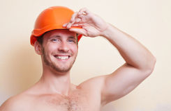Attractive young man in a helmet Royalty Free Stock Images