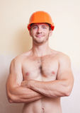 Attractive young man in a helmet Royalty Free Stock Photography