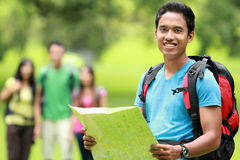 Attractive young man hiking with map Stock Images