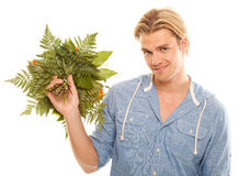 Attractive young man holding Stock Image