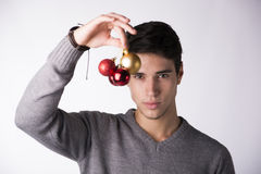 Attractive young man holding Christmas tree balls Royalty Free Stock Photography