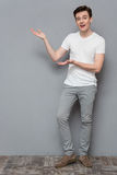 Attractive young man holding copyspace on palms Royalty Free Stock Photography