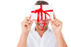 Attractive young man holding a gift Royalty Free Stock Photos
