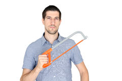 Attractive young man holding a handsaw. A portrait of attractive young man holding a handsaw Royalty Free Stock Photo