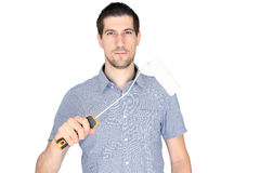 Attractive young man holding a paint brush. A portrait of attractive young man holding a paint brush Stock Images