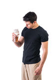 Attractive young man holding protein shake bottle Stock Photos