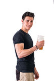 Attractive young man holding protein shake bottle Stock Image