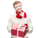 Attractive young man holding red gift Stock Image