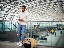 Attractive young man inside modern building royalty free stock image