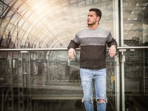 Attractive young man inside modern building stock images