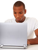 Attractive young man with laptop Stock Photography
