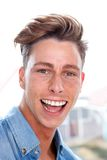 Attractive young man laughing Stock Images