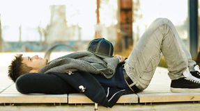 Attractive young man laying on bench Royalty Free Stock Image