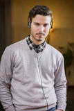 Attractive young man listening to music on headphones at home Stock Photo