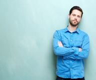 Attractive young man looking at camera with arms crossed Royalty Free Stock Photography