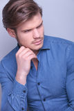 Attractive young man looking to his side Royalty Free Stock Photography