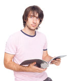 Attractive young man with magazine Stock Photos