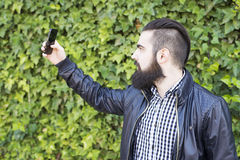 Attractive young man makes a selfie. stock photography