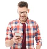 Attractive young man with mobile phone. On white background Royalty Free Stock Photos