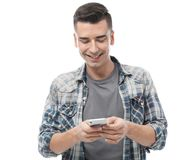 Attractive young man with mobile phone. On white background Stock Images