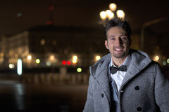 Attractive young man at night in Piazza Vittorio Veneto in Turin Royalty Free Stock Photos