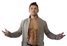 Attractive young man with open jacket on muscular torso stock images