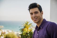 Attractive young man outdoor looking over a Stock Images